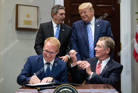 Stock Image of US President Donald Trump (R), Stavros Lambrinidis, the Ambassador of the European Union to the United States, US Trade Representative Robert Lighthizer (bottom right) and Jani Raappana (L), Deputy Head of Mission, for the Finnish Presidency of the Council of the EU, sign a trade deal on US beef exports to the European Union, in the Roosevelt Room at the White House in Washington, DC, USA, 02 August 2019.
