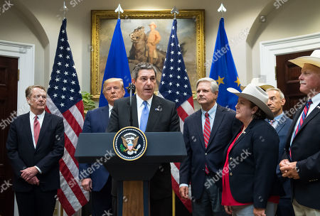 Stavros Lambrinidis, the Ambassador of the European Union to the United States, speaks alongside US President Donald Trump, US Trade Representative Robert Lighthizer (L), Sen. John Hovan, R-ND, and members of the beef industry as he speaks on a US beef trade deal with the European Union, in the Roosevelt Room at the White House in Washington, DC, USA, 02 August 2019.