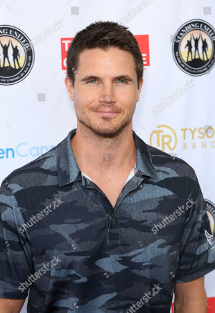 Stock Photo of Robbie Amell attends the Mike Tyson Standing United and the Tyson Ranch Celebrity Golf Tournament, in Dana Point, Calif