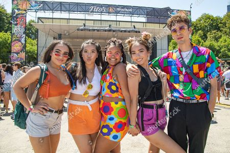 ARTIST. Festival goers Brianna Brown, Aaleah Vuong, Libertee Simpson,Hanh Bui, and Andy Sedano from Sioux City, Iowa attend day two of Lollapalooza in Grant Park, in Chicago
