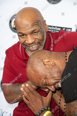 Mike Tyson and Tommy Lister share a moment of fun