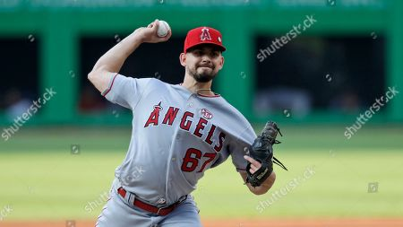 Los Angeles Angels starting pitcher Taylor Cole delivers in the first inning of the team's baseball game against the Cleveland Indians, in Cleveland
