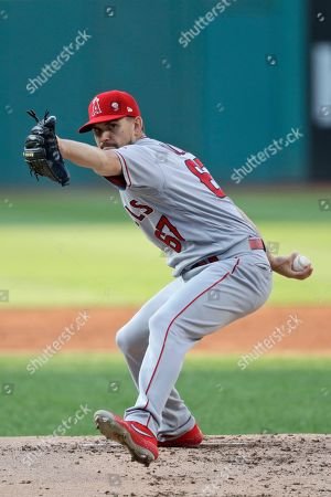 Los Angeles Angels starting pitcher Taylor Cole delivers in the first inning of a baseball game against the Cleveland Indians, in Cleveland