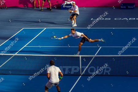 Monegasque players Romain Arneodo (top), and Hugo Nys (C) in action against Santiago Gonzalez from Mexico, and Aisam-ul-Haq Qureshi from Pakistan, during the doubles semifinal of the Los Cabos Open tennis tournament in Los Cabos, Baja California, Mexico, 02 August 2019.
