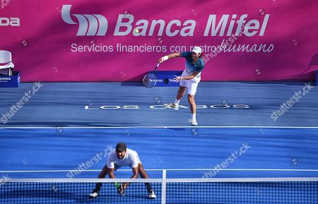 The Mexican player Santiago Gonzalez (top) and Aisam-ul-Haq Qureshi (bottom) of Pakistan in action against the Monegasques Romain Arneodo and Hugo Nys during the doubles semifinal of the Los Cabos Open tennis tournament in Los Cabos, Baja California, Mexico, 02 August 2019.