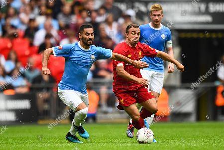Xherdan Shaqiri of Liverpool and Ilkay Gundogan of Manchester City