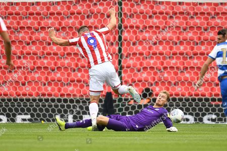 Goal Keeper Joe Lumley of Queens Park Rangers makes a save from Sam Vokes of Stoke City.