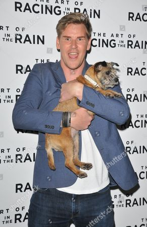 Stock Picture of Craig Stevens with Lottie the dog