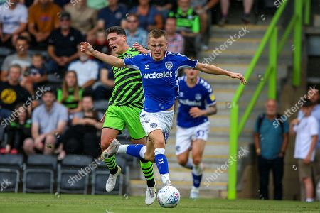 Oldham Athletic defender Thomas Hamer (34) tussles with Forest Green Rovers forward Matthew Stevens (9)  during the EFL Sky Bet League 2 match between Forest Green Rovers and Oldham Athletic at the New Lawn, Forest Green