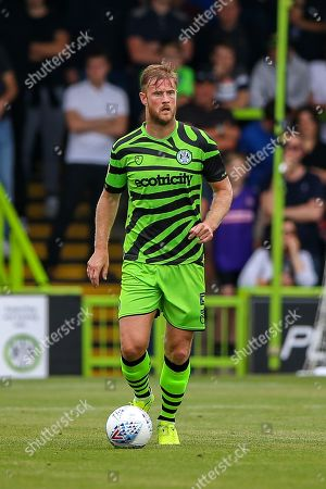 Stock Photo of Forest Green Rovers defender Matthew Mills (5) during the EFL Sky Bet League 2 match between Forest Green Rovers and Oldham Athletic at the New Lawn, Forest Green