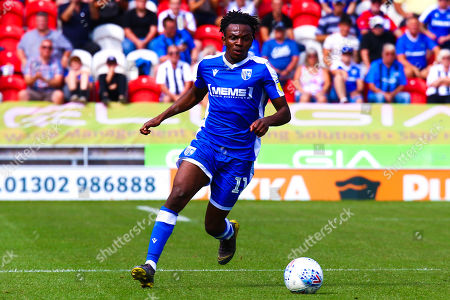 Stock Image of Regan Charles-Cook of Gillingham runs on the ball
