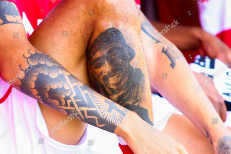 Stock Picture of A Tupac Shakur tattoo on the leg of Alex Kiwomya of Doncaster Rovers