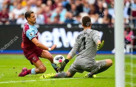 Chicharito (Javier Hernandez) of West Ham United has a shot at goal saves by Unai Simon goalkeeper of Athletic Bilbao