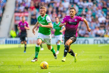 Ilkay Durmas (#11) of St Mirren FC chases the ball as Tom James (#17) of Hibernian FC watches on during the Ladbrokes Scottish Premiership match between Hibernian and St Mirren at Easter Road Stadium, Edinburgh
