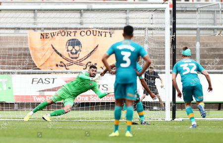 Tom King of Newport County saves apenalty from Nicky Maynard of Mansfield Town.