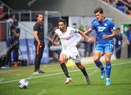 Hoffenheim's Steven Zuber (R) in action against Sevilla's Jesus Navas (L) during the friendly soccer match between TSG 1899 Hoffenheim and Sevilla FC in Sinsheim, Germany, 03 August 2019.