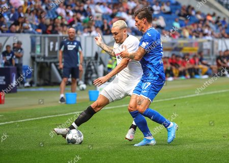 Stock Image of Hoffenheim's Steven Zuber (R) in action against Sevilla's Lucas Ocampos (L) during the friendly soccer match between TSG 1899 Hoffenheim and Sevilla FC in Sinsheim, Germany, 03 August 2019.