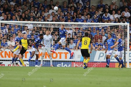Ipswich Town defender James Wilson heads the ball clear from goal during the EFL Sky Bet League 1 match between Burton Albion and Ipswich Town at the Pirelli Stadium, Burton upon Trent