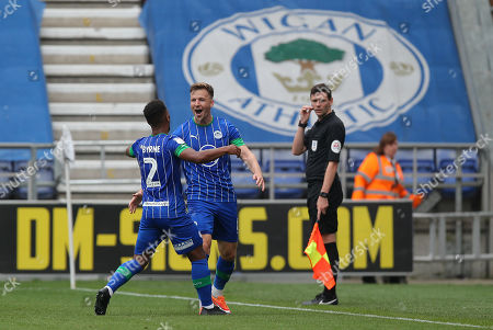 Lee Evans of Wigan Athletic celebrates his goal with Nathan Byrne of Wigan Athletic