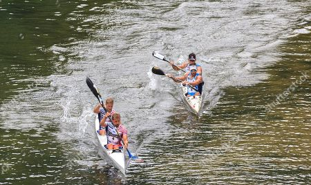 Spanish canoeists Jose Julian Becerro and Miguel Fernandez (R) and French Quentin Urban and Jeremy Candi (L) compete in the 83th International Descent of the Sella River canoeing event in Arriondas, Asturias, northern Spain, 03 August 2019. Some 1,100 canoiest took part in the race.