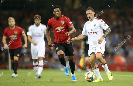 Davide Calabria of A.C. Milan with Anthony Martial of Manchester United