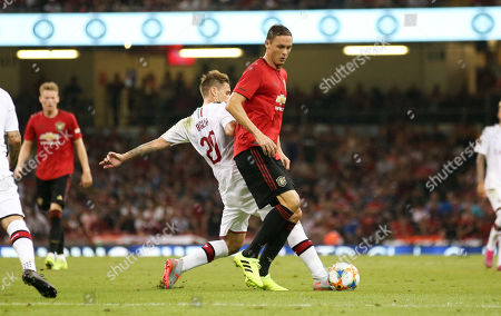 Nemanja Matic of Manchester United dispossessed by Lucas Biglia of A.C. Milan