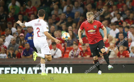Luke Shaw of Manchester United controls a pass with Davide Calabria of A.C. Milan
