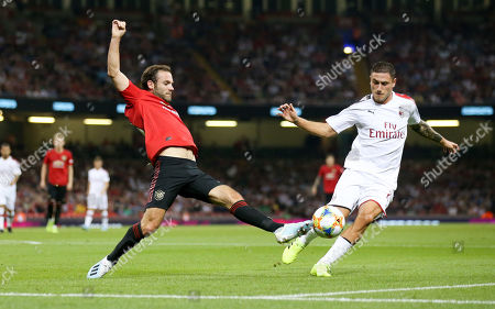 Juan Mata of Manchester United stretches for a ball as Davide Calabria of A.C. Milan looks to tackle