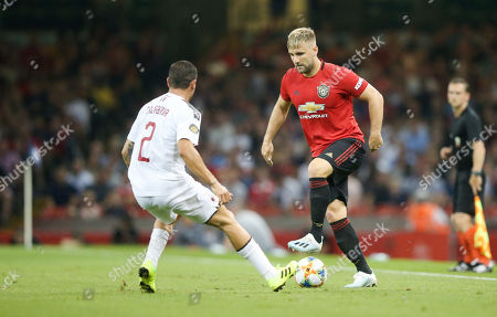 Luke Shaw of Manchester United takes oin Davide Calabria of A.C. Milan