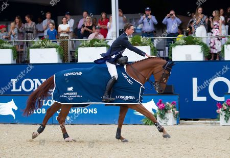 Ben Maher (GBR) riding explosion on a lap of honour following his win in the Longines Global Champions Tour Grand Prix in London