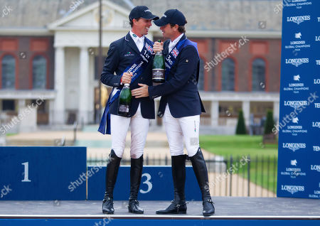 Ben Maher (GBR) celebrates with Darragh Kenny (IRL) after winning the Global Champions Tour Grand Prix in London