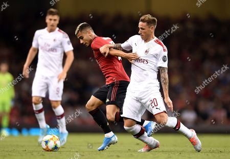 Andreas Pereira of Manchester United is tackled by Lucas Biglia of AC Milan.