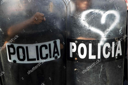 Police agents block the way to a demonstration by health workers, in Managua, Nicaragua, 03 August 2019. Protesters are demanding from President Daniel Ortega to reinstate workers who were fired for attending to injured people during opposition demonstrations. Since April 2018, opposition demonstrations in the country demanding the resignation of President Ortega take place regularly.