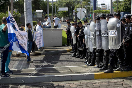Health workers demonstrate in front anti-riot police agents, in Managua, Nicaragua, 03 August 2019. Protesters are demanding from President Daniel Ortega to reinstate workers who were fired for attending to injured people during opposition demonstrations. Since April 2018, opposition demonstrations in the country demanding the resignation of President Ortega take place regularly.