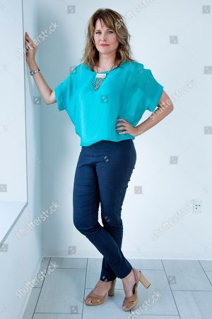 """This photo shows actress Lucy Lawless posing for a portrait in New York to promote her new crime TV series """"My Life Is Murder,"""" which premieres on Acorn TV starting Aug. 5"""