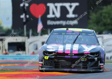 """Jimmie Johnson (48) drives through the area of the course called """"The Bus Stop"""" during a practice run for the NASCAR Cup Series auto race at Watkins Glen International, in Watkins Glen, New York"""