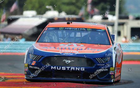 """Brad Keselowski (2) heads through the area known as """"The Bus Stop"""" during a practice run for a NASCAR Cup Series auto race at Watkins Glen International, in Watkins Glen, N.Y"""
