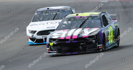 Jimmie Johnson (48) heads into Turn 1 during a practice for the NASCAR Cup Series auto race at Watkins Glen International, in Watkins Glen, N.Y