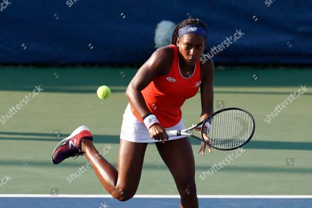 Cori Gauff returns the ball as she and Caty McNally played against Fanny Stollar, of Hungary, and Maria Sanchez in the women's doubles final at the Citi Open tennis tournament, in Washington