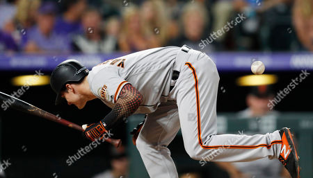 Stock Image of R m. San Francisco Giants' Mike Yastrzemski gets hit by a pitch thrown by Colorado Rockies reliever Sam Howard during the eighth inning of a baseball game, in Denver