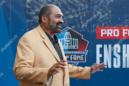 Former NFL player Franco Harris is introduced before the induction ceremony at the Pro Football Hall of Fame, in Canton, Ohio
