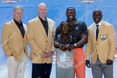 From left to right, former NFL players John Ellway, Gary Zimmerman, Shannon Sharpe and Terrell Davis pose with the bust of former Denver Broncos owner Pat Bowlen during the induction ceremony at the Pro Football Hall of Fame, in Canton, Ohio