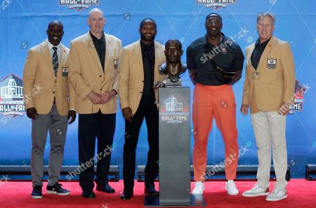Former NFL player Champ Bailey, third from left, poses with, from left to right, Terrell Davis, Gary Zimmerman, Shannon Sharpe and John Elway during the induction ceremony at the Pro Football Hall of Fame, in Canton, Ohio