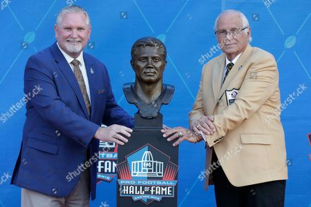 Former NFL player Johnny Robinson, right, poses with his presenter, Bob Thompson, during the induction ceremony at the Pro Football Hall of Fame, in Canton, Ohio