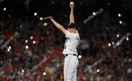 Houston Astros starting pitcher Aaron Sanchez stretches on the mound during the sixth inning of the team's baseball game against the Seattle Mariners, in Houston