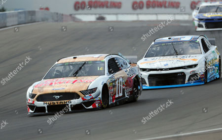 Aric Almirola (10) heads into turn one during a practice run for the NASCAR Cup Series auto race at Watkins Glen International, in Watkins Glen, N.Y
