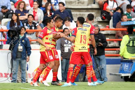 Edison Flores (2-R) of Morelia celebrates with teammates after scoring against Pachuca during day three of the Mexican soccer tournament at the Hidalgo Stadium in Pachuca, Mexico, 03 August 2019.