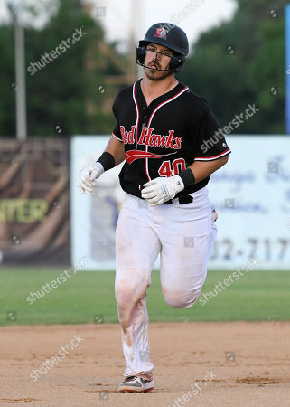 FM Redhawks catcher Daniel Comstock (40) rounds the bases after hitting a three run homerun in the seventh inning of the FM Redhawks game against the Winnipeg Goldeyes in American Association professional baseball at Newman Outdoor Field in Fargo, ND. The Redhawks won 8-4