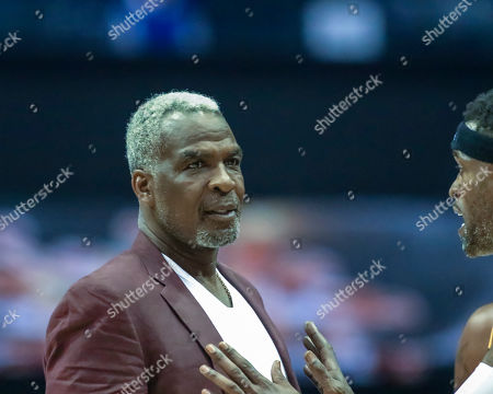 Saturday  - Killer 3's head coach Charles Oakley discusses strategy during the Big3 game between Killer 3's vs Bivouac at the Allstate Arena in Rosemont, IL. Gary E