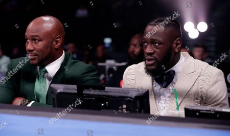 Fight Night announcers former heavyweight champion Lennox Lewis (L) and current WBC heavyweight champion Deontay Wilder (R) are seen during the Adam Kownacki vs Chris Arreola heavyweight fight at the Barclays Center in Brooklyn, New York, USA, 03 August 2019.